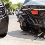 two damaged cars after a rear end collision