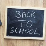 "chalk board that reads ""back to school"""