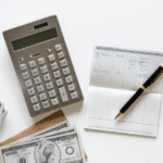 calculator, checkbook, and cash