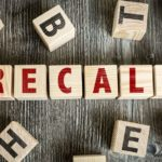 "wood blocks spelling out ""recall"""